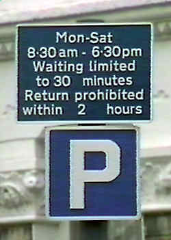 Sign shows can park for 30 minutes, no return within 2 hours.